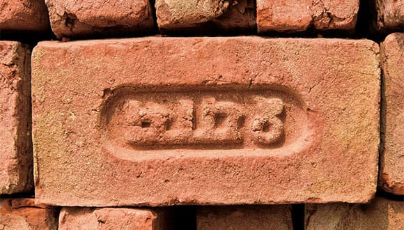 Sanskrit script on brick surface